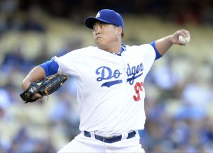 Jun 16, 2014; Los Angeles, CA, USA; Los Angeles Dodgers starting pitcher Hyun-Jin Ryu (99) throws in the first inning against the Colorado Rockies at Dodger Stadium. Mandatory Credit: Robert Hanashiro-USA TODAY Sports