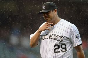 Jun 8, 2014; Denver, CO, USA; Colorado Rockies starting pitcher Jorge De La Rosa (29) reacts after being pulled in the sixth inning against the Los Angeles Dodgers at Coors Field. Mandatory Credit: Ron Chenoy-USA TODAY Sports