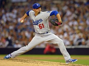 Jun 21, 2014; San Diego, CA, USA; Los Angeles Dodgers starting pitcher Josh Beckett (61) pitches during the fifth inning against the San Diego Padres at Petco Park. Mandatory Credit: Jake Roth-USA TODAY Sports