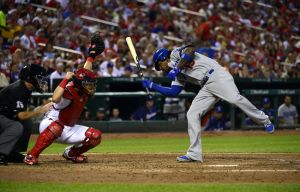 Jul 20, 2014; St. Louis, MO, USA; Los Angeles Dodgers shortstop Hanley Ramirez (13) is hit by a pitch from St. Louis Cardinals starting pitcher Carlos Martinez (not pictured) during the fourth inning at Busch Stadium. Mandatory Credit: Jeff Curry-USA TODAY Sports