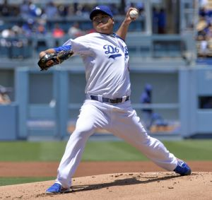 Jul 13, 2014; Los Angeles, CA, USA; Los Angeles Dodgers starting pitcher Hyun-Jin Ryu (99) throws in the first inning against the San Diego Padres at Dodger Stadium. Mandatory Credit: Robert Hanashiro-USA TODAY Sports