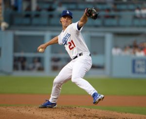 Jul 30, 2014; Los Angeles, CA, USA; Los Angeles Dodgers starter Zack Greinke (21) delivers a pitch against the Atlanta Braves at Dodger Stadium. Mandatory Credit: Kirby Lee-USA TODAY Sports