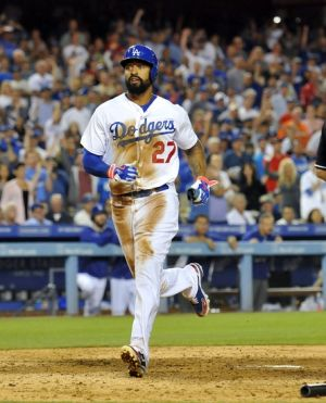 August 5, 2014; Los Angeles, CA, USA; Los Angeles Dodgers left fielder Matt Kemp (27) scores a run in the sixth inning against the Los Angeles Angels at Dodger Stadium. Mandatory Credit: Gary A. Vasquez-USA TODAY Sports