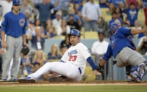 Aug 1, 2014; Los Angeles, CA, USA; Los Angeles Dodgers first baseman Adrian Gonzalez (23) is tagged out at home plate by Chicago Cubs catcher Welington Castillo (5) in the first inning during the game at Dodger Stadium. Mandatory Credit: Richard Mackson-USA TODAY Sports