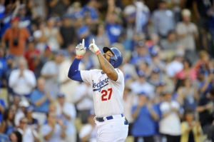 September 1, 2014; Los Angeles, CA, USA; Los Angeles Dodgers left fielder Matt Kemp (27) celebrates after he hits a two run home run in the first inning against the Washington Nationals at Dodger Stadium. Mandatory Credit: Gary Vasquez-USA TODAY Sports