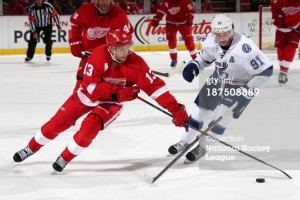 DETROIT, MI - NOVEMBER 9: Pavel Datsyuk #13 of the Detroit Red Wings and Steven Stamkos #91 of the Tampa Bay Lightning battle for the puck during an NHL game at Joe Louis Arena on November 9, 2013 in Detroit, Michigan. Tampa Bay defeated Detroit 3-2 in OT (Photo by Dave Reginek/NHLI via Getty Images)