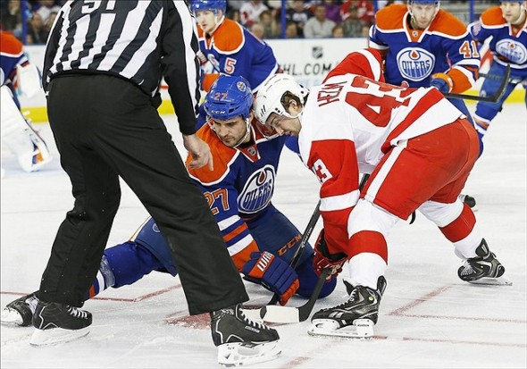 Nov 2, 2013; Edmonton, Alberta, CAN; Edmonton Oilers forward Boyd Gordon (27) and Detroit Red Wings Darren Helm (43) battle for a puck during the second period at Rexall Place. Mandatory Credit: Perry Nelson-USA TODAY Sports