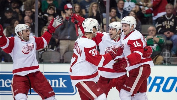 Jan 4, 2014; Dallas, TX, USA; Detroit Red Wings right wing Mikael Samuelsson (37) and left wing Tomas Tatar (21) and center Joakim Andersson (18) celebrate Andersson