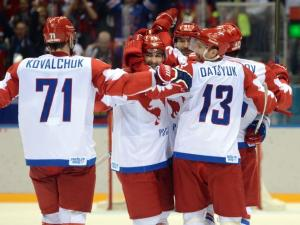 Russia forward Pavel Datsyuk (13) is congratulated by teammates after scoring a goal against USA during the third period. MANDATORY CREDIT - Jayne Kamin-Oncea, USA TODAY Sports