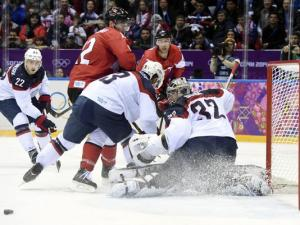 USA goalie Jonathan Quick (32) makes a save against Canada in the men's ice hockey semifinals.(Photo: Scott Rovak, USA TODAY Sports)
