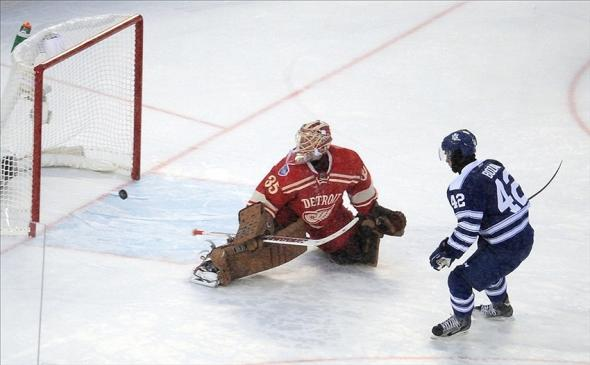 Jan 1, 2014; Ann Arbor, MI, USA; Toronto Maple Leafs center Tyler Bozak (42) scores the winning shootout goal past Detroit Red Wings goalie Jimmy Howard (35) during the 2014 Winter Classic hockey game at Michigan Stadium. Mandatory Credit: Tim Fuller-USA TODAY Sports