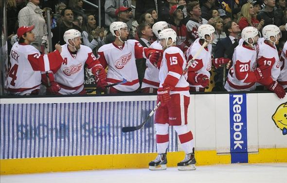 January 11, 2014; Los Angeles, CA, USA; Detroit Red Wings center Riley Sheahan (15) is congratulated after scoring a goal against the Los Angeles Kings during the first period at Staples Center. Mandatory Credit: Gary A. Vasquez-USA TODAY Sports
