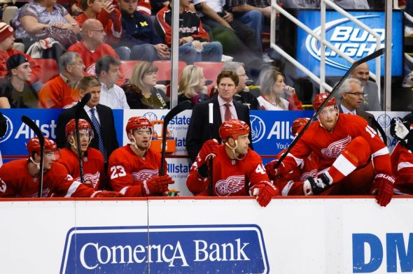 Sep 25, 2013; Detroit, MI, USA; Detroit Red Wings head coach Mike Babcock (center) during the game against the Pittsburgh Penguins at Joe Louis Arena. Mandatory Credit: Rick Osentoski-USA TODAY Sports