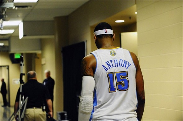 Feb 4, 2011; Denver, CO, USA; Denver Nuggets small forward Carmelo Anthony (15) walks in the tunnel of the Pepsi Center on his way back to the locker room after the Nugget lost to the Utah Jazz 113-106. Mandatory Credit: Ron Chenoy-USA TODAY Sports
