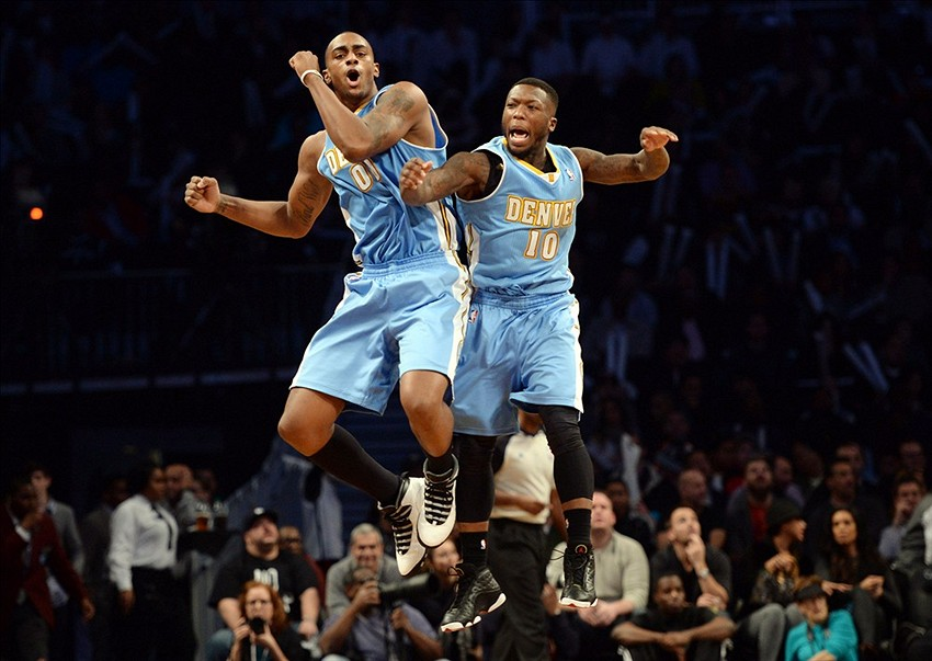 Dec 3, 2013; Brooklyn, NY, USA; Denver Nuggets power forward Darrell Arthur (00) and point guard Nate Robinson (10) celebrate against the Brooklyn Nets during the second half at Barclays Center. The Nuggets won the game 111-87. Mandatory Credit: Joe Camporeale-USA TODAY Sports