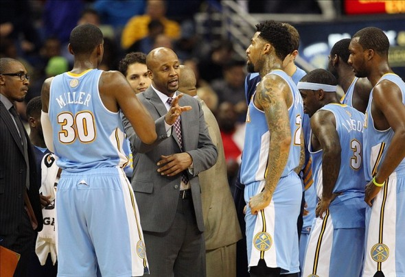 Dec 27, 2013; New Orleans, LA, USA; Denver Nuggets head coach Brian Shaw talks with his team in the second half against the New Orleans Pelicans at the New Orleans Arena. New Orleans defeated Denver 105-89. Mandatory Credit: Crystal LoGiudice-USA TODAY Sports