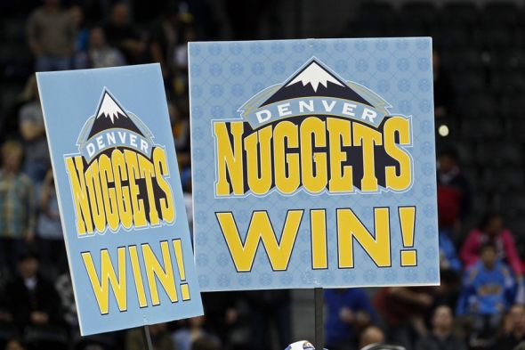 Dec 15, 2013; Denver, CO, USA; Fans hold signs after the Denver Nuggets defeated the New Orleans Pelicans at the Pepsi Center. The Nuggets won 102-93. Mandatory Credit: Isaiah J. Downing-USA TODAY Sports