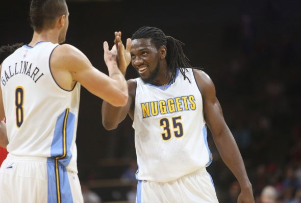 Oct 8, 2015; Boulder, CO, USA; Denver Nuggets forward Kenneth Faried (35) celebrates with forward Danilo Gallinari (8) during the first half against the Chicago Bulls at Coors Events Center. Mandatory Credit: Chris Humphreys-USA TODAY Sports