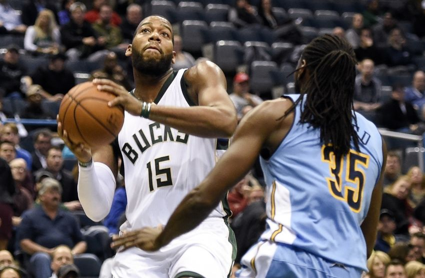 Nov 30, 2015; Milwaukee, WI, USA;   Milwaukee Bucks center Greg Monroe (15) takes a shot against Denver Nuggets forward Kenneth Faried (35) at BMO Harris Bradley Center. Monroe scored 18 points as the Bucks beat the Nuggets 92-74. Mandatory Credit: Benny Sieu-USA TODAY Sports