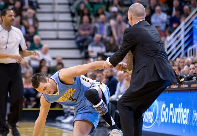 Feb 3, 2016; Salt Lake City, UT, USA; Denver Nuggets head coach Michael Malone helps forward Danilo Gallinari (8) up from the court during the first half against the Utah Jazz at Vivint Smart Home Arena. Mandatory Credit: Russ Isabella-USA TODAY Sports
