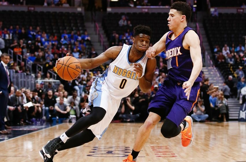 Mar 10, 2016; Denver, CO, USA; Phoenix Suns guard Devin Booker (1) guards Denver Nuggets guard Emmanuel Mudiay (0) in the second quarter at the Pepsi Center. Mandatory Credit: Isaiah J. Downing-USA TODAY Sports