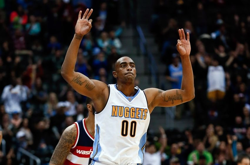 Mar 12, 2016; Denver, CO, USA; Denver Nuggets forward Darrell Arthur (00) celebrates after a play in the fourth quarter against the Washington Wizards at the Pepsi Center. The Nuggets defeated the Wizards 116-100. Mandatory Credit: Isaiah J. Downing-USA TODAY Sports