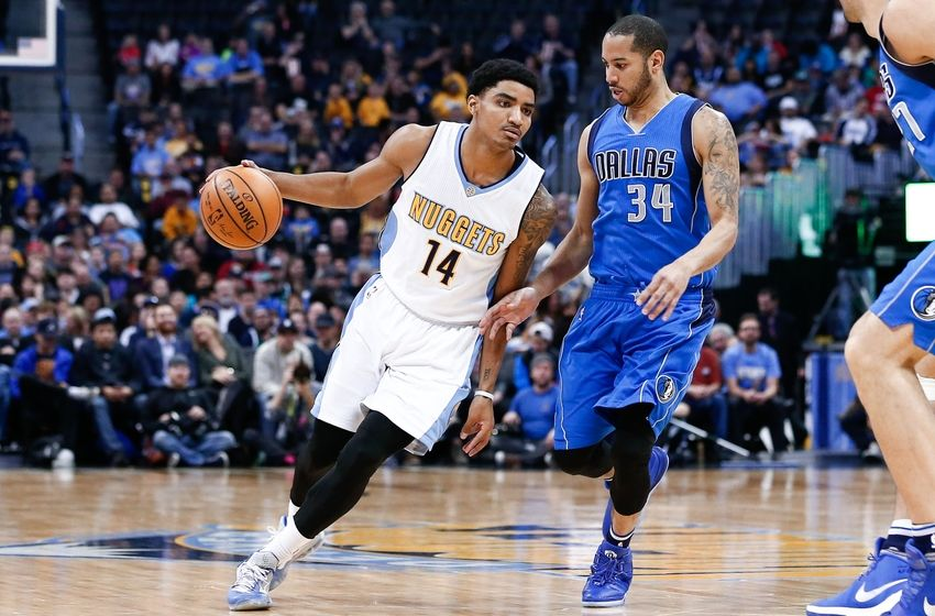 Mar 28, 2016; Denver, CO, USA; Denver Nuggets guard Gary Harris (14) dribbles the ball around Dallas Mavericks guard Devin Harris (34) in the first quarter at the Pepsi Center. The Mavericks defeated the Nuggets 97-88. Mandatory Credit: Isaiah J. Downing-USA TODAY Sports