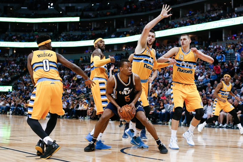 Apr 10, 2016; Denver, CO, USA; Utah Jazz guard Rodney Hood (5) controls the ball against Denver Nuggets center Jusuf Nurkic (23) and center Nikola Jokic (15) and forward Will Barton (5) and guard Emmanuel Mudiay (0) in the second quarter at the Pepsi Center. Mandatory Credit: Isaiah J. Downing-USA TODAY Sports