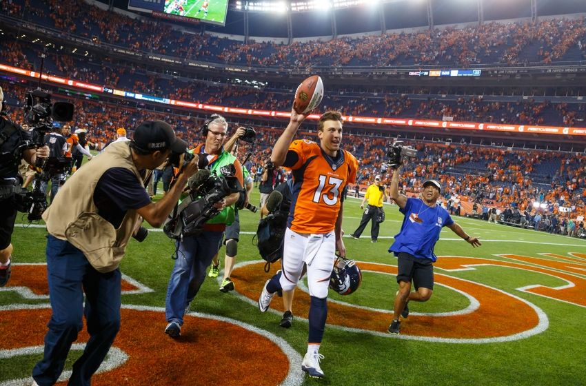 Sep 8, 2016; Denver, CO, USA; Denver Broncos quarterback Trevor Siemian (13) celebrates following the game against the Carolina Panthers at Sports Authority Field at Mile High. The Broncos defeated the Panthers 21-20. Mandatory Credit: Mark J. Rebilas-USA TODAY Sports