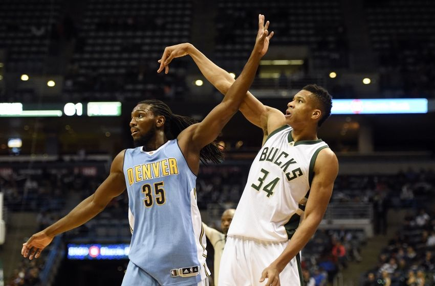Nov 30, 2015; Milwaukee, WI, USA;  Denver Nuggets forward Kenneth Faried (35) watches a shot by Milwaukee Bucks forward Giannis Antetokounmpo (34) in the third quarter at BMO Harris Bradley Center. Mandatory Credit: Benny Sieu-USA TODAY Sports