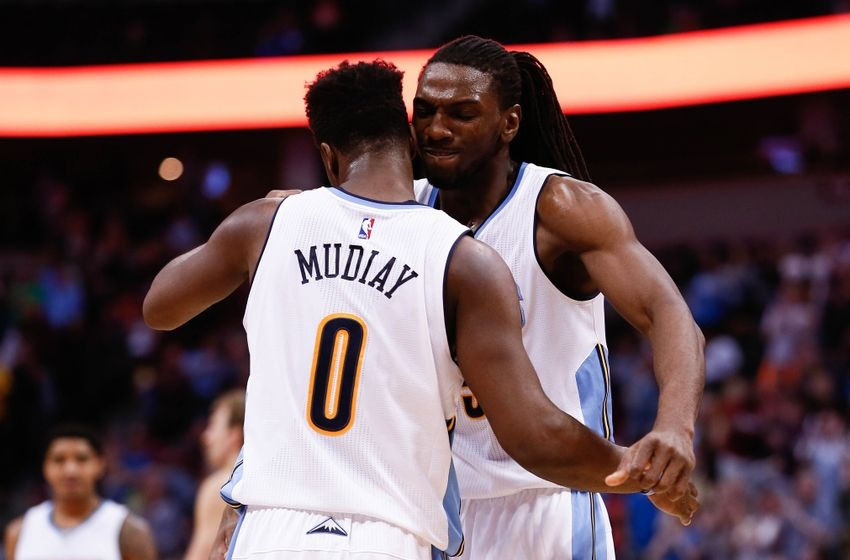 Mar 6, 2016; Denver, CO, USA; Denver Nuggets forward Kenneth Faried (35) celebrates with guard Emmanuel Mudiay (0) after a play in the fourth quarter against the Dallas Mavericks at the Pepsi Center. The Nuggets defeated the Mavericks 116-114 in overtime. Mandatory Credit: Isaiah J. Downing-USA TODAY Sports