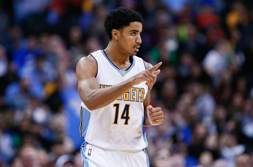 Mar 28, 2016; Denver, CO, USA; Denver Nuggets guard Gary Harris (14) in the third quarter against the Dallas Mavericks at the Pepsi Center. The Mavericks defeated the Nuggets 97-88. Mandatory Credit: Isaiah J. Downing-USA TODAY Sports