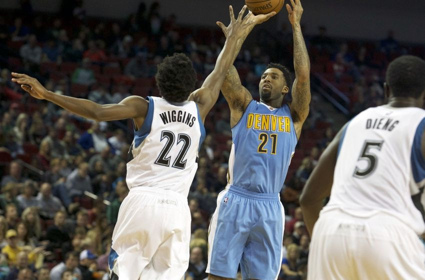 ... Wilson Chandler (21) shoots over Minnesota Timberwolves forward Andrew  Wiggins (22) in the second half at Pinnacle Bank Arena. Minnesota won  105-88. b39ac9d14