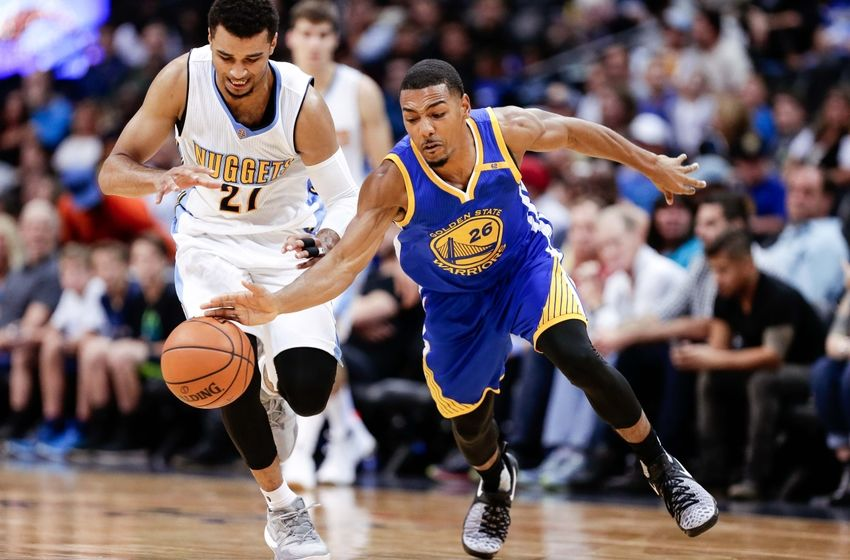 Oct 14, 2016; Denver, CO, USA; Golden State Warriors guard Phil Pressey (26) and Denver Nuggets guard Jamal Murray (27) battle for the ball in overtime at the Pepsi Center. The Warriors won 129-128. Mandatory Credit: Isaiah J. Downing-USA TODAY Sports