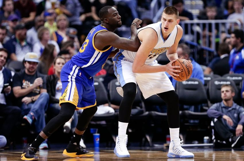 Oct 14, 2016; Denver, CO, USA; Golden State Warriors forward Draymond Green (23) defends Denver Nuggets center Nikola Jokic (15) in the third quarter at the Pepsi Center. The Warriors won 129-128. Mandatory Credit: Isaiah J. Downing-USA TODAY Sports