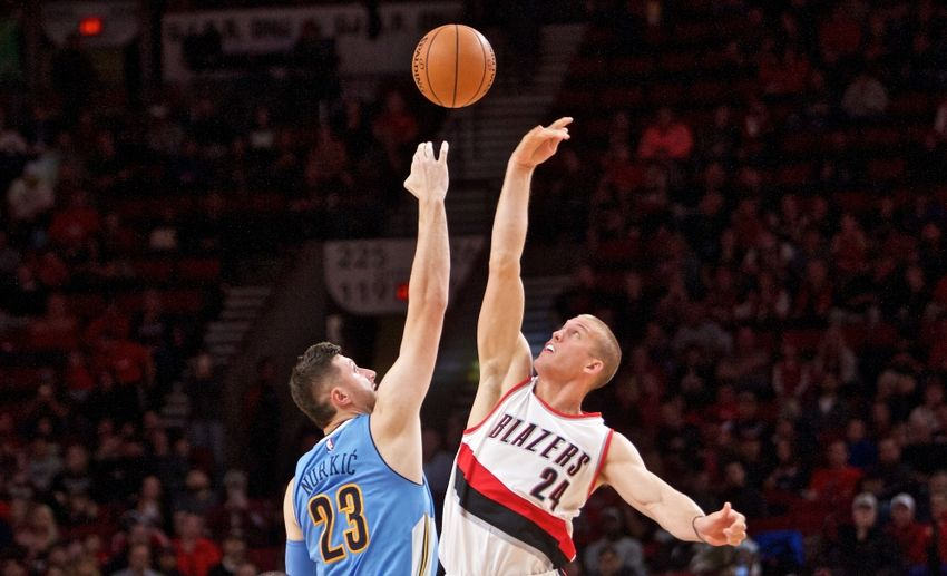 Oct 16, 2016; Portland, OR, USA; Denver Nuggets center Jusuf Nurkic (23) and Portland Trail Blazers forward Mason Plumlee (24) jump for the ball during the first quarter at the Moda Center. Mandatory Credit: Craig Mitchelldyer-USA TODAY Sports
