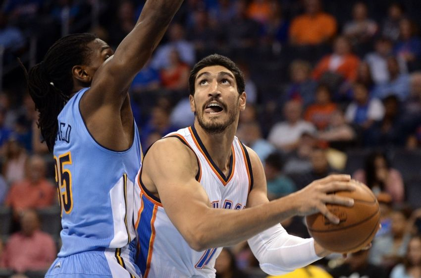 Oct 18, 2016; Oklahoma City, OK, USA; Oklahoma City Thunder center Enes Kanter (11) drives to the basket in front of Denver Nuggets forward Kenneth Faried (35) during the third quarter at Chesapeake Energy Arena. Mandatory Credit: Mark D. Smith-USA TODAY Sports