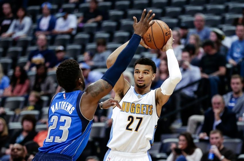 Oct 21, 2016; Denver, CO, USA; Dallas Mavericks guard Wesley Matthews (23) defends against Denver Nuggets guard Jamal Murray (27) in the first quarter at the Pepsi Center. Mandatory Credit: Isaiah J. Downing-USA TODAY Sports