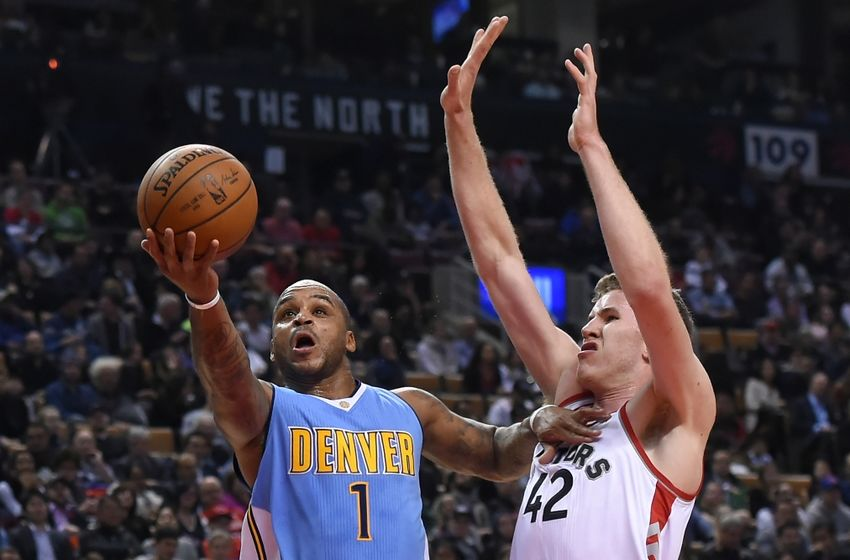Oct 31, 2016; Toronto, Ontario, CAN; Denver Nuggets guard Jameer Nelson (1) shoots for a basket past Toronto Raptors center Jakob Poeltl (42) in the first half at Air Canada Centre. Mandatory Credit: Dan Hamilton-USA TODAY Sports