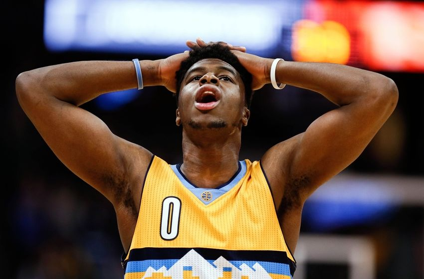 Mar 4, 2016; Denver, CO, USA; Denver Nuggets guard Emmanuel Mudiay (0) reacts after a play in the fourth quarter against the Brooklyn Nets at the Pepsi Center. The Nets defeated the Nuggets 121-120 in overtime. Mandatory Credit: Isaiah J. Downing-USA TODAY Sports