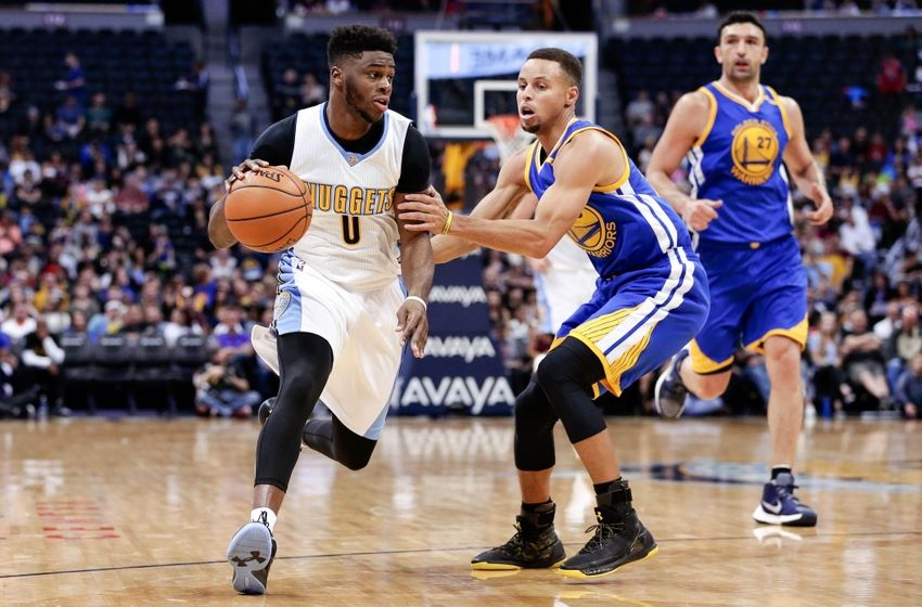 Oct 14, 2016; Denver, CO, USA; Denver Nuggets guard Emmanuel Mudiay (0) dribbles the ball against Golden State Warriors guard Stephen Curry (30) in the second quarter at the Pepsi Center. Mandatory Credit: Isaiah J. Downing-USA TODAY Sports