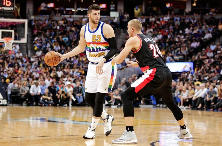 Oct 29, 2016; Denver, CO, USA; Denver Nuggets center Jusuf Nurkic (23) dribbles the ball as Portland Trail Blazers forward Mason Plumlee (24) defends in the first quarter at the Pepsi Center. Mandatory Credit: Isaiah J. Downing-USA TODAY Sports