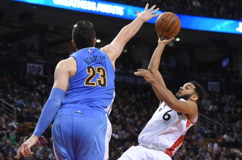 Oct 31, 2016; Toronto, Ontario, CAN; Toronto Raptors guard Cory Joseph (6) takes a shot for a basket over Denver Nuggets center Jusuf Nurkic (23) in the fourth quarter at Air Canada Centre. The Raptors won 105-102. Mandatory Credit: Dan Hamilton-USA TODAY Sports