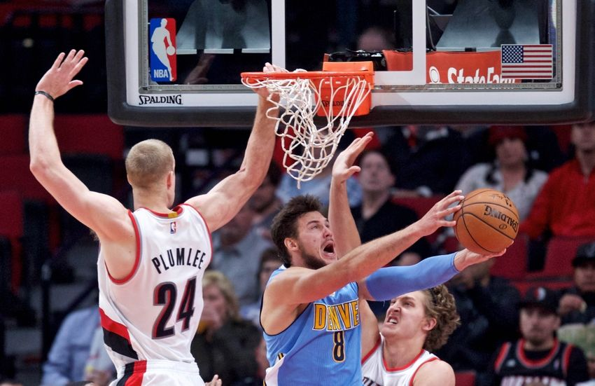 Nov 13, 2016; Portland, OR, USA; Denver Nuggets forward Danilo Gallinari (8) shoots over Portland Trail Blazers forward Mason Plumlee (24) and forward Meyers Leonard (11) during the third quarter at the Moda Center. Mandatory Credit: Craig Mitchelldyer-USA TODAY Sports