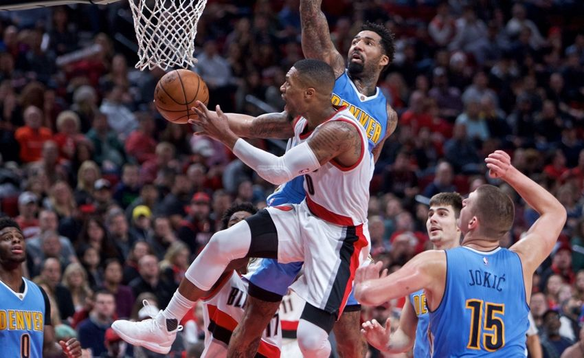 Nov 13, 2016; Portland, OR, USA; Portland Trail Blazers guard Damian Lillard (0) shoots over Denver Nuggets forward Wilson Chandler (21) during the fourth quarter at the Moda Center. Mandatory Credit: Craig Mitchelldyer-USA TODAY Sports
