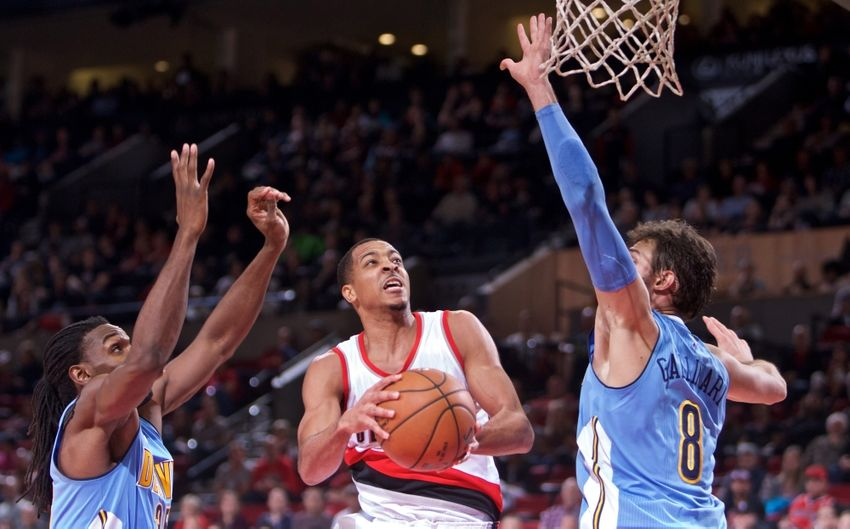 Nov 13, 2016; Portland, OR, USA; Portland Trail Blazers guard C.J. McCollum (3) shoots over Denver Nuggets forward Kenneth Faried (35) and forward Danilo Gallinari (8) during the fourth quarter at the Moda Center. Mandatory Credit: Craig Mitchelldyer-USA TODAY Sports