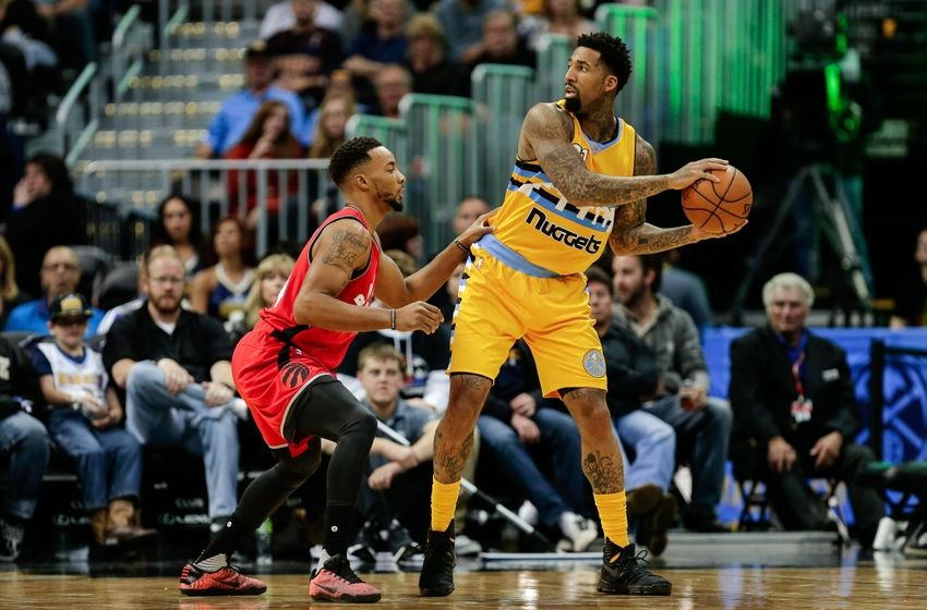 Nov 18, 2016; Denver, CO, USA; Toronto Raptors guard Norman Powell (24) guards Denver Nuggets forward Wilson Chandler (21) in the third quarter at the Pepsi Center. The Raptors won 113-111 in overtime. Mandatory Credit: Isaiah J. Downing-USA TODAY Sports