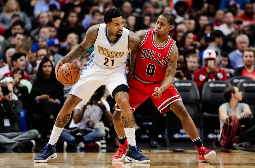 Nov 22, 2016; Denver, CO, USA; Chicago Bulls guard Isaiah Canaan (0) guards Denver Nuggets forward Wilson Chandler (21) in the third quarter at the Pepsi Center. The Nuggets defeated the Bulls 110-107. Mandatory Credit: Isaiah J. Downing-USA TODAY Sports