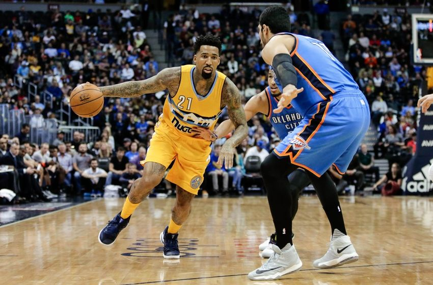 Nov 25, 2016; Denver, CO, USA; Denver Nuggets forward Wilson Chandler (21) drives to the basket against Oklahoma City Thunder center Enes Kanter (11) in the second quarter at the Pepsi Center. Mandatory Credit: Isaiah J. Downing-USA TODAY Sports