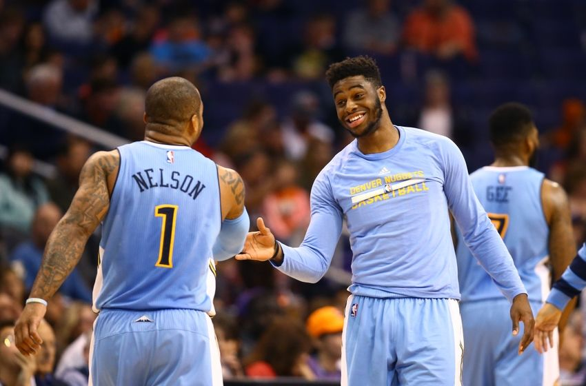 Nov 27, 2016; Phoenix, AZ, USA; Denver Nuggets guard Emmanuel Mudiay (right) celebrates a play with Jameer Nelson (1) in the second quarter against the Phoenix Suns at Talking Stick Resort Arena. Mandatory Credit: Mark J. Rebilas-USA TODAY Sports